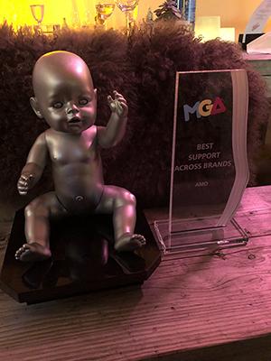 Amo Toys team recieving award.